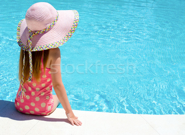 Young girl sat by the pool  Stock photo © Freila