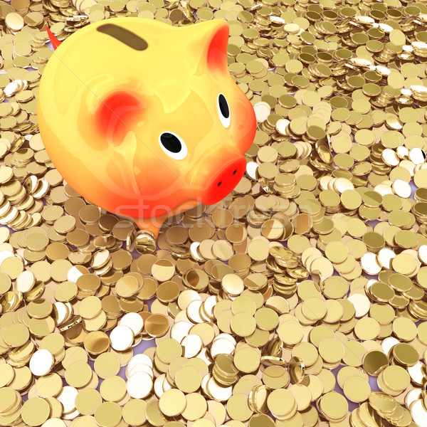 Pink piggy bank standing on a many of golden coins Stock photo © frescomovie