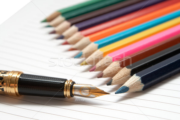 Office tools. Golden Pen and colored wooden pencils Stock photo © frescomovie