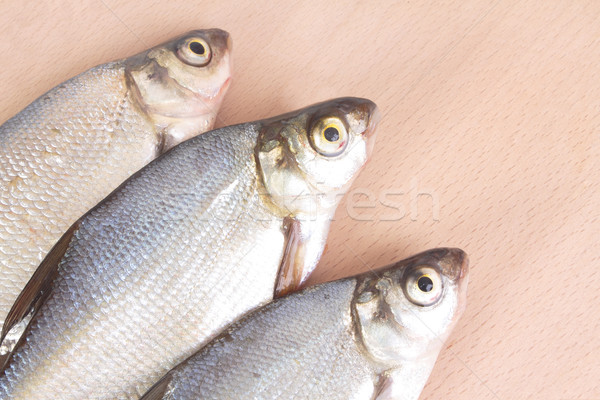 Fish fry on a wooden board. Isolated on white Stock photo © frescomovie