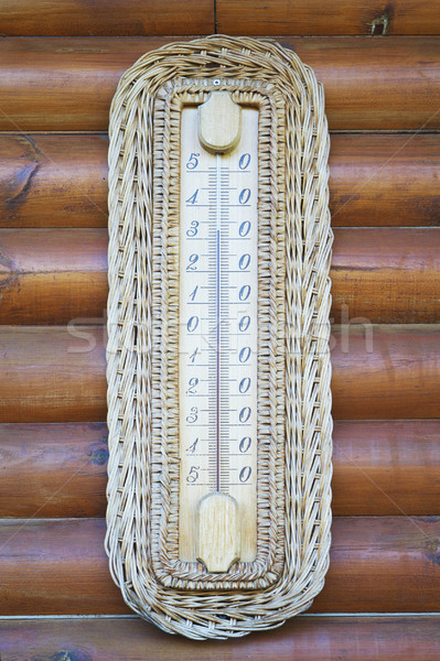 Thermometer on wooden wall Stock photo © frescomovie