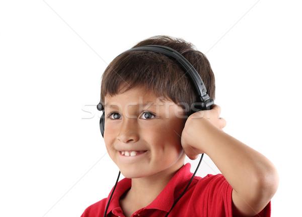 Jeunes écouter casque rouge shirt Photo stock © Freshdmedia