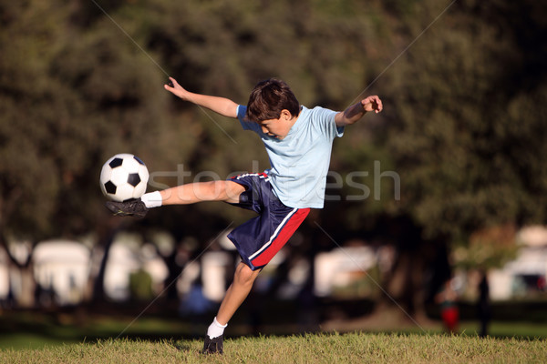 Young boy with soccer ball in park Stock photo © Freshdmedia