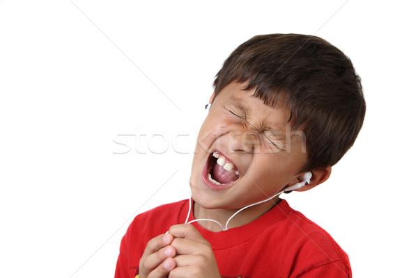 Garçon casque chanter blanche espace de copie enfant Photo stock © Freshdmedia