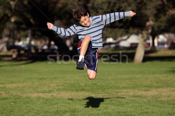 Fiú játszik park autentikus tevékenység vidám fiú Stock fotó © Freshdmedia
