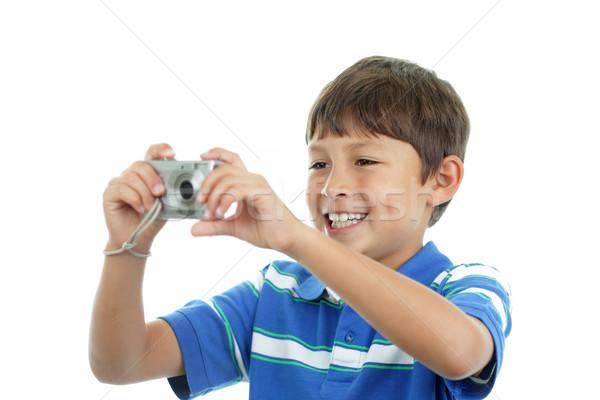 Fiatal srác kamera mosoly lövés fiú gyerek Stock fotó © Freshdmedia