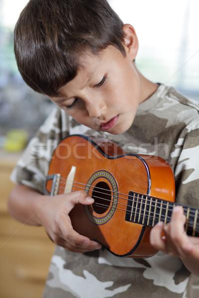 Fiú játszik gitár fiatal srác boldog játék Stock fotó © Freshdmedia