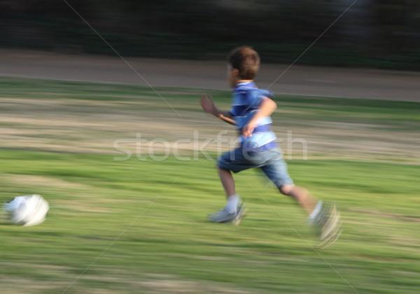 Mozgás elmosódott fotó fiú fut labda Stock fotó © Freshdmedia