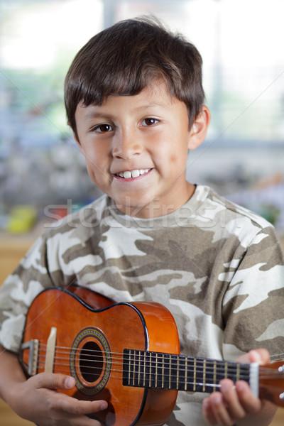 Fiú játszik gitár fiatal mosolyog boldog Stock fotó © Freshdmedia