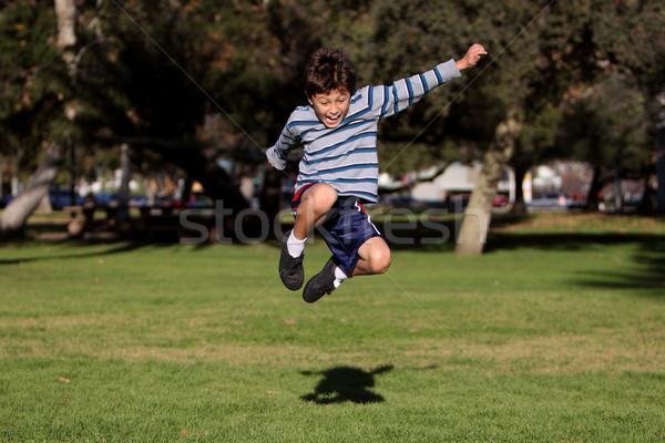 Fiú ugrik park autentikus tevékenység fiatal Stock fotó © Freshdmedia