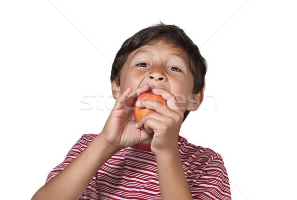 Garçon manger pomme blanche fruits Photo stock © Freshdmedia