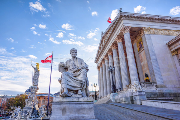 Roman statue at historic building of the austrian parliament in  Stock photo © frimufilms