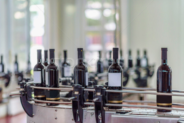 Wine bottling and sealing conveyor Stock photo © frimufilms