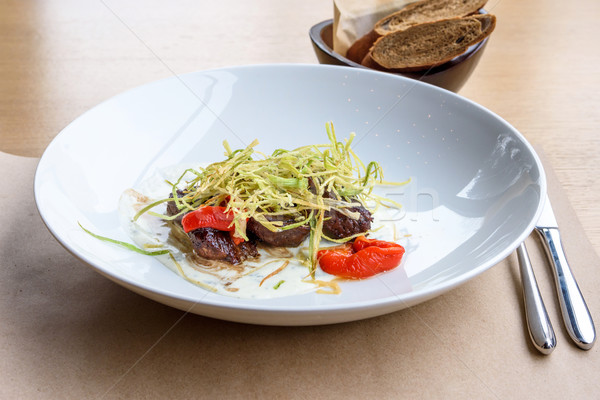 Beef medallions with greens Stock photo © frimufilms