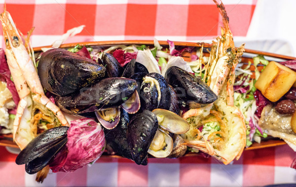 Prown,shrimp and mussels with rocket salad dish served in restau Stock photo © frimufilms