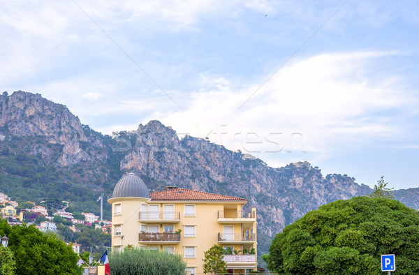 Daylight view to a hotel and big mountains in Beaulieu sur mer Stock photo © frimufilms