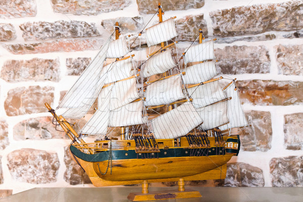 Miniature ship over brick background Stock photo © frimufilms