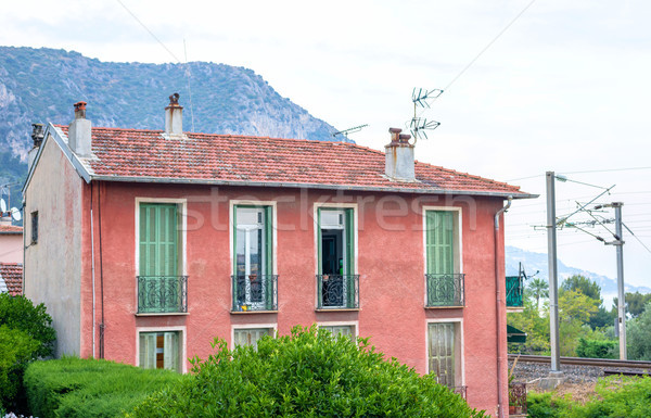 Beautiful sunset view to a red old house or apartments in Beauli Stock photo © frimufilms