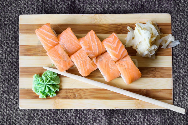 Philadelphia salmon sushi rolls on a wooden plate Stock photo © frimufilms