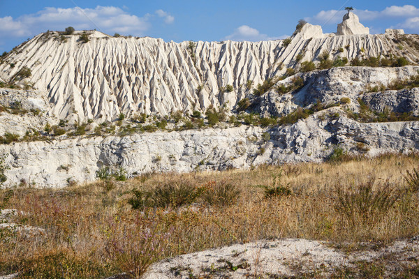 View on hills and fields from a limestone cliff Stock photo © frimufilms