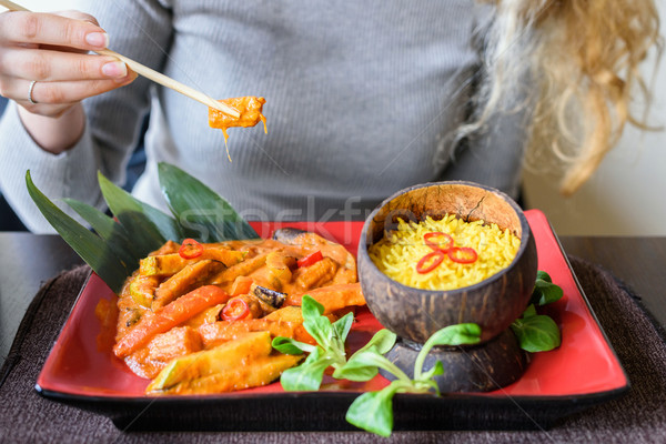 Woman with blonde hair eating with chopsticks Stock photo © frimufilms