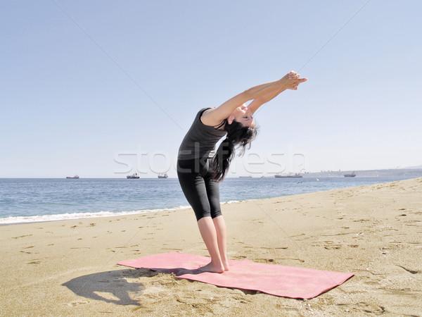 Bikram yoga arda chandrasana pose at beach Stock photo © fxegs
