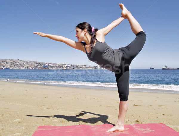 Bikram yoga dandayamana dhanurasana pose at beach Stock photo © fxegs