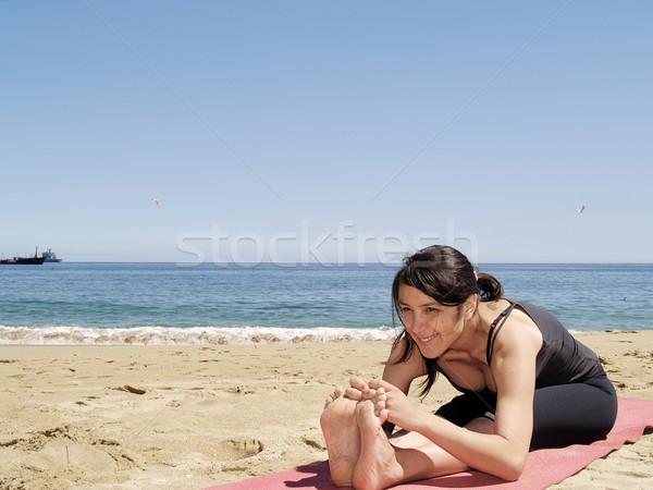 Bikram yoga sit-up pose at beach Stock photo © fxegs