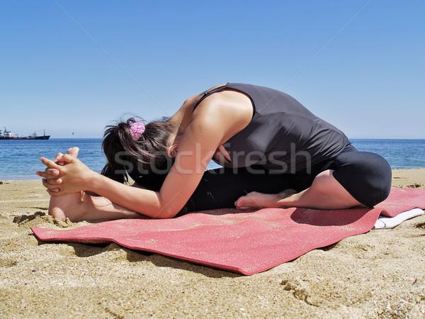 Bikram yoga janushirasana pose at beach Stock photo © fxegs