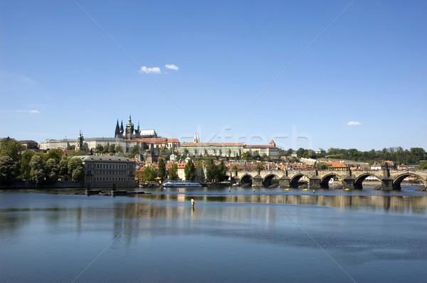 Kilátás Prága kastély víz felhők épület Stock fotó © fyletto