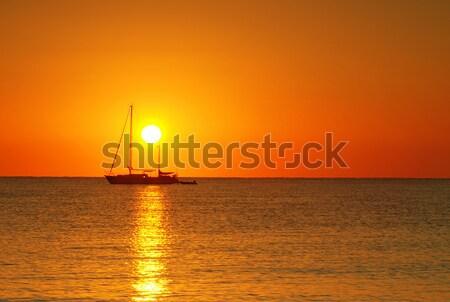 Stock photo: Sunrise and boat