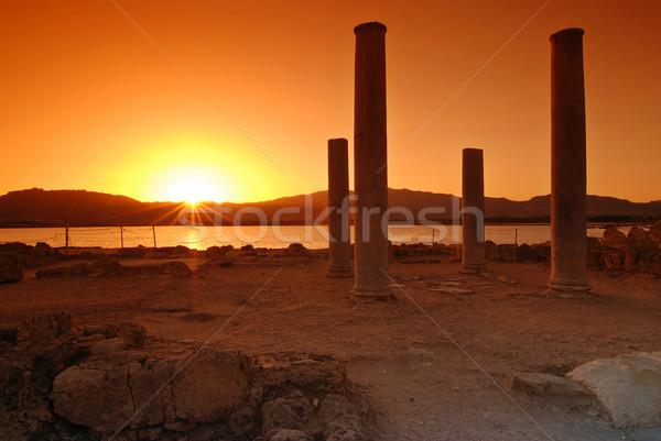 Zonsondergang ruines stad hemel water zon Stockfoto © fyletto