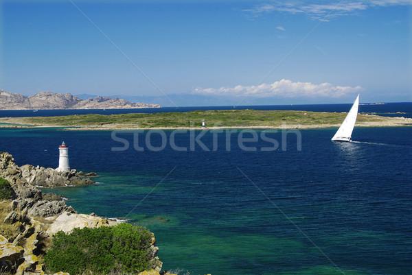 Yacht phare roches voile mer océan Photo stock © fyletto