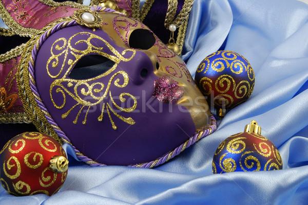 Beautiful Venetian mask on red velvet Stock photo © fyletto