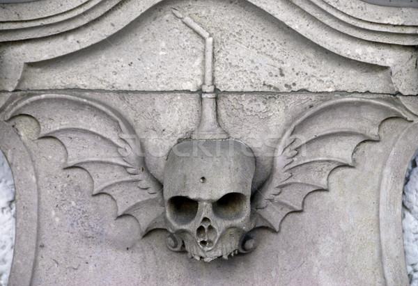 Koponya kő sír halál ijesztő pokol Stock fotó © fyletto