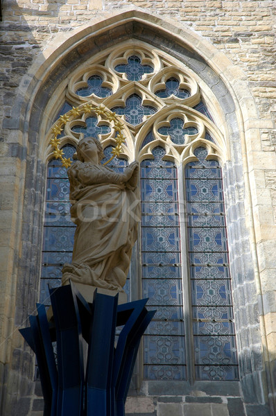 Statue of saint and a window of church Stock photo © fyletto