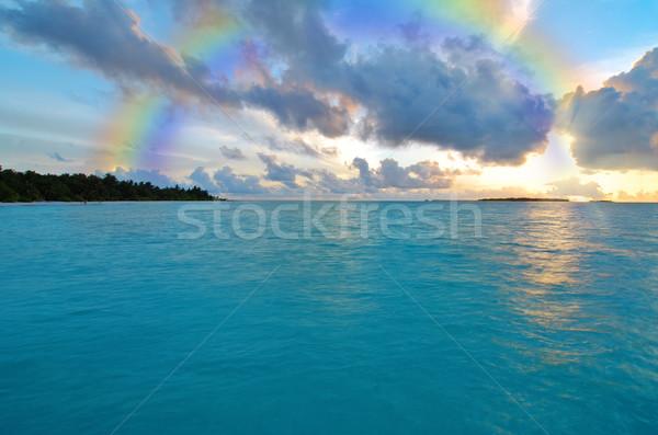 Wygaśnięcia tęczy ocean niebo słońce streszczenie Zdjęcia stock © fyletto