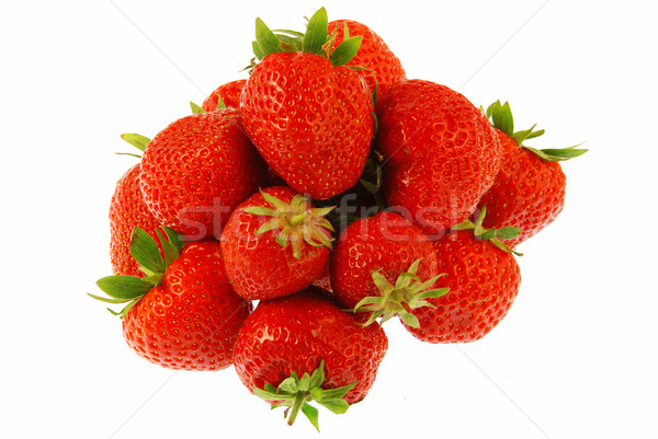 Veel aardbeien vruchten geïsoleerd witte uit Stockfoto © fyletto