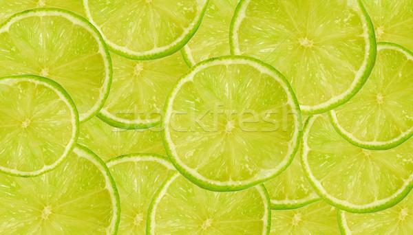 Limón fondo frescos jugoso cal rebanadas Foto stock © fyletto