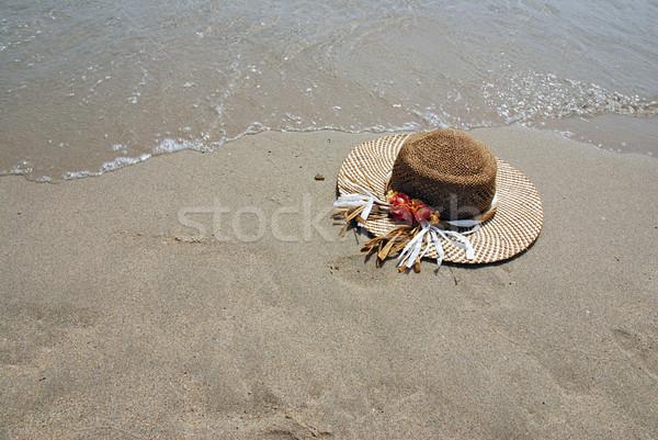 Straw hat on the beach Stock photo © fyletto