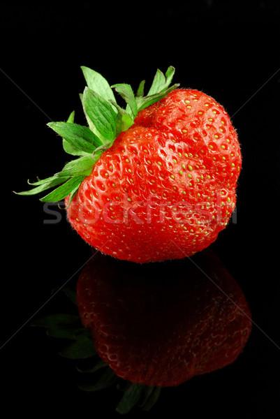 Strawberry on black Stock photo © fyletto