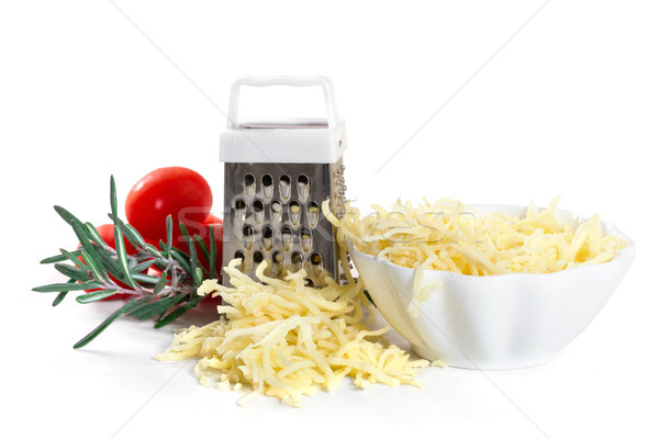 Grated cheese with grater and tomatoes on white background Stock photo © g215