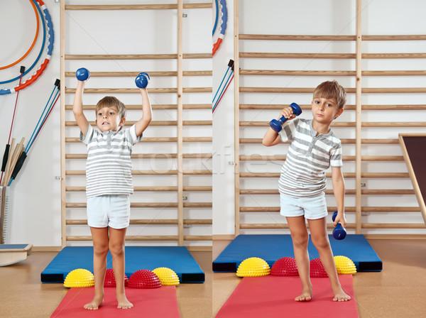 Fiú súlyzó tornaterem épület sport csoport Stock fotó © g215