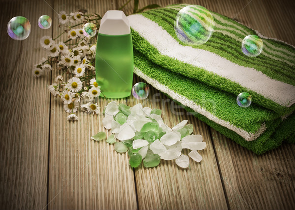 Towel and bath salts. Spa background with bubbles. Stock photo © g215