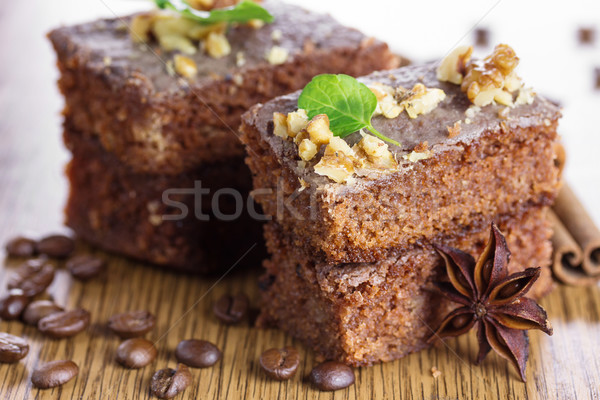 Slice of chocolate cake with nuts. Small Depth of Field (DOF)  Stock photo © g215