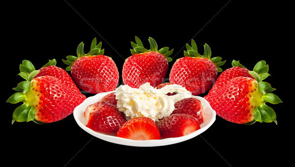 Strawberries and cream, isolated on black background. Stock photo © g215