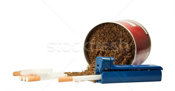 Device for packing cigarettes and tobacco liners. Stock photo © g215