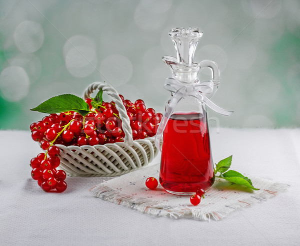 Red currant berries with syrup Stock photo © g215