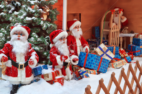 The group of Santa Clauses with gifts Stock photo © g215