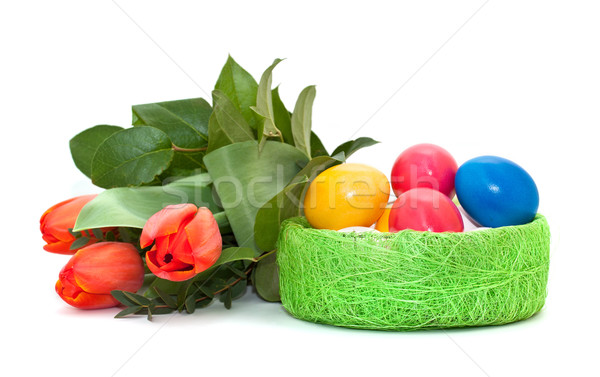 Easter eggs with a bouquet of tulips Stock photo © g215